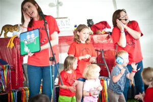 Singing about the cheeky monkeys with some helpers at 'Disability Rocks' Festival, Kibworth